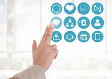 Doctor touching digitally generated medical icons against white background Royalty Free Stock Photography