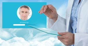 Doctor touching glass tablet and Identity Verify App Interface. Digital composite of Doctor touching glass tablet and Identity Verify App Interface Royalty Free Stock Images