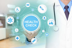 Doctor touching HEALTH CHECK sign on virtual screen. Doctor hand touching HEALTH CHECK sign linked with medical icon network on virtual screen Royalty Free Stock Images