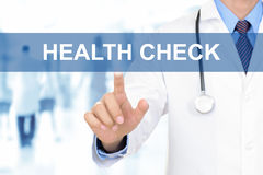 Doctor touching HEALTH CHECK sign on virtual screen. Doctor hand touching HEALTH CHECK tab on virtual screen Stock Image