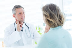 Doctor touching his pulse Royalty Free Stock Photography