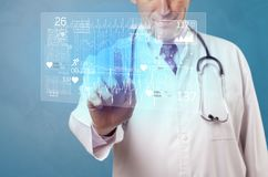 Person touching light blue hologram screen. Doctor touching hologram screen displaying healthcare running symbolsn stock photos