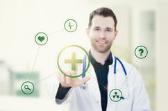 Doctor touching screen with icons. Futuristic medicine concept stock photography