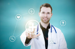 Doctor touching screen with icons. Futuristic medicine concept Stock Photos