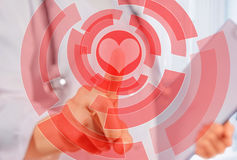 Doctor is touching shape of red heart Royalty Free Stock Image