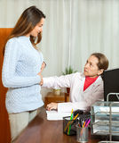 Doctor touching  stomach female patient Royalty Free Stock Images