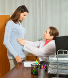 Doctor touching  stomach of  girl Royalty Free Stock Photos