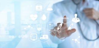 Doctor touching white icon medical on virtual screen, medical te Stock Photo