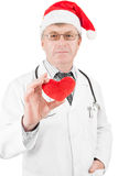 Doctor with toy heart in hand royalty free stock photo
