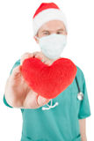 Doctor with toy heart in hand stock photo