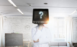 Doctor with TV instead of head . Mixed media royalty free stock photo