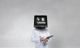 Doctor with TV instead of head . Mixed media . Mixed media stock images
