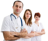 Doctor with two assistants. Looking confidently stock photo