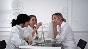Doctor and two female students working with documents in office. stock footage