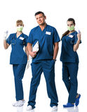 Doctor, two nurses in blue  dress Stock Photos