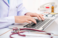 Doctor typing on computer Stock Photos
