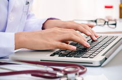 Doctor typing on computer Royalty Free Stock Image