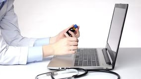 Doctor typing on the computer and searching something, white stock footage