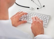 Doctor typing on keyboard Royalty Free Stock Images