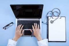 Doctor typing on keyboard 1 Stock Photography