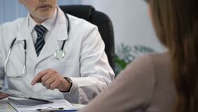 Doctor typing patient's data on tablet, keeping medical records, consultation. Stock footage stock video footage