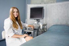 Doctor and ultrasound equipment Stock Images