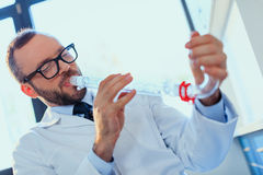 Doctor in uniform working at testing laboratory at clinic, clinical laboratory Royalty Free Stock Image