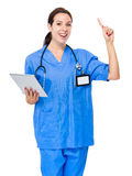 Doctor use tablet and finger up Stock Photo