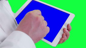 Doctor uses a tablet computer closeup. Chroma key background stock video footage