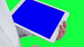 Doctor uses a tablet computer closeup. Chroma key background stock video