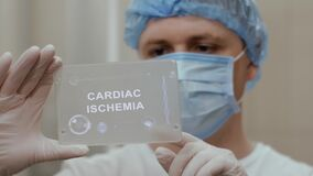 Doctor uses tablet with text Cardiac Ischemia