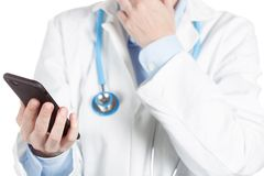 Doctor using a cell phone stock images