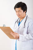Doctor using clipboard Stock Photos