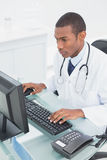 Doctor using computer at medical office Stock Photos