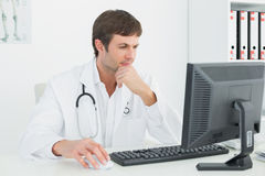 Doctor using computer at medical office Royalty Free Stock Photo
