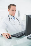 Doctor using computer at medical office Stock Image