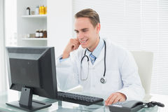 Doctor using computer at medical office Royalty Free Stock Images