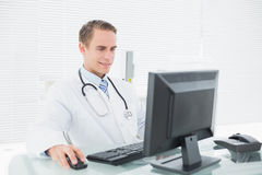 Doctor using computer at medical office Royalty Free Stock Photography