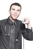 Doctor Using Computer Mouse For Online Medicine. Young Male Doctor Holding Up Computer Mouse When Checking Online For Self Diagnosis Virtual Treatment Royalty Free Stock Photos