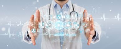 Doctor using digital medical futuristic interface 3D rendering. Doctor on blurred background using digital medical futuristic interface 3D rendering Stock Photos