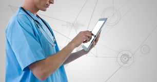 Doctor using digital tablet against digitally generated background Stock Image