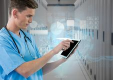 Doctor using digital tablet against digitally generated data room Royalty Free Stock Photography