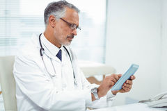 Doctor using digital tablet Stock Photography