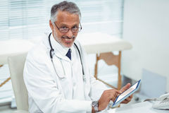 Doctor using digital tablet at clinic Stock Image