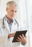 Doctor Using Digital Tablet At Clinic Stock Images