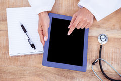 Doctor using digital tablet Royalty Free Stock Photos