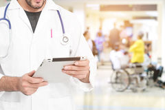 Doctor using digital tablet find information patient medical his Stock Photography