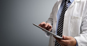 Doctor using digital tablet stock image