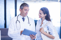 Doctor using digital tablet and having a discussion Stock Images