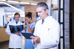 Doctor using digital tablet in hospital Stock Photography
